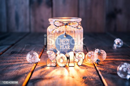 istock New Year 2019: Christmas decoration on old wood - Candle Jar Label Card 1030409098