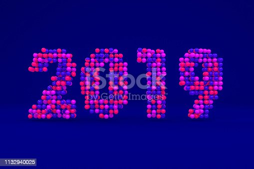 istock New year 2019. Colorful spheres on dark blue background. 3d rendering 1132940025