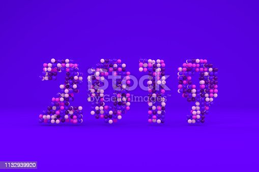 istock New year 2019. Colorful spheres on purple background. 1132939920