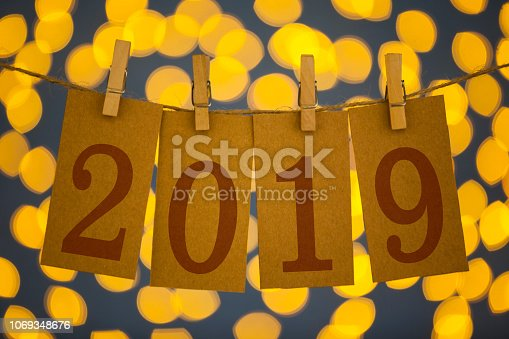 1069595584 istock photo New Year 2019 Concept Clipped Cards and Lights 1069348676
