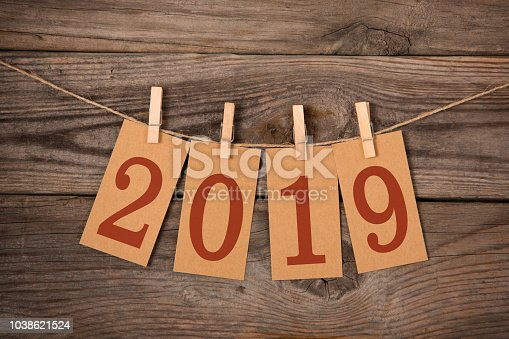 1069595584 istock photo New Year 2019 Concept Clipped Cards 1038621524
