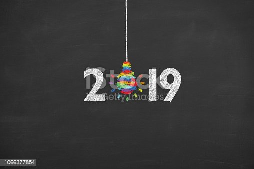 942417132istockphoto New Year 2019 Creative Concepts on Blackboard 1066377854