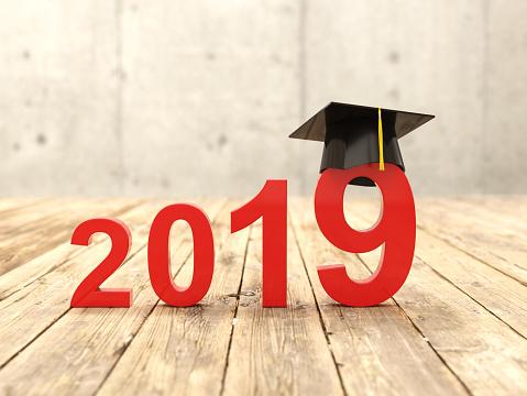 istock New Year 2019 Creative Design Concept with Graduation cap 1046288384