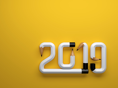 istock New Year 2019 Creative Design Concept with Pencil 1046643326
