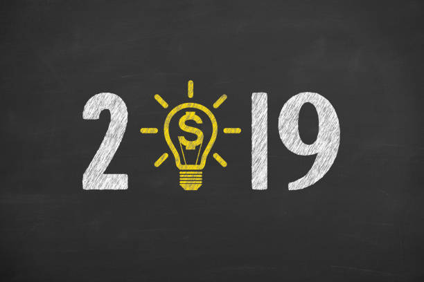 New Year 2019 Finance Concepts on Chalkboard Background stock photo
