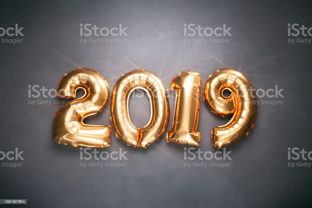 New Year 2019 - Golden balloons on blackboard - Christmas Decoration Gold Holiday stock photo