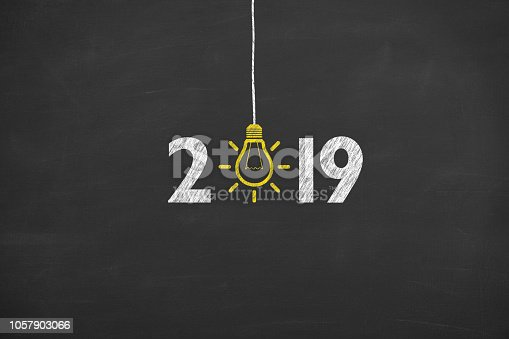 1069595584 istock photo New Year 2019 Idea Concepts on Chalkboard Background 1057903066