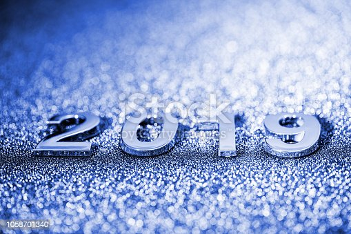 1018011484 istock photo New Year 2019 on a sparkling defocused background (blue) 1058701340