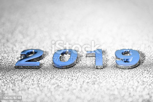 1018011484 istock photo New Year 2019 on a sparkling defocused background (gray) 1062678748