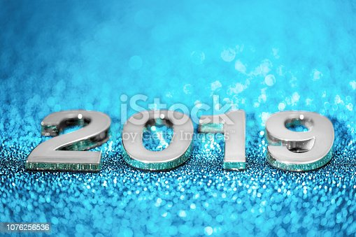 1018011484 istock photo New Year 2019 on a sparkling defocused background (blue) 1076256536