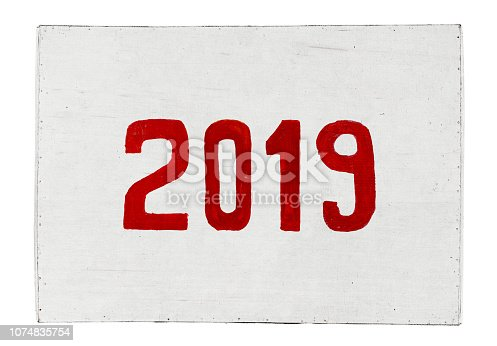 istock New year 2019 painted on plywood board. Year of the Pig. 1074835754