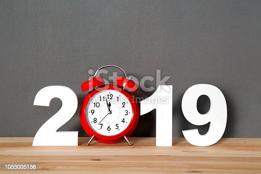 New year 2019 written with numbers and alarm on the desk