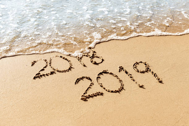 New Year 2019 New Year 2019 replace 2018 on the sea beach summer concept 2019 stock pictures, royalty-free photos & images