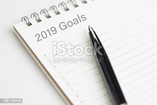 1186985932 istock photo New year 2019 resolution or writing goals, to do list or work target plan concept, black pen on notepad with header as 2019 Goals with list of numbers on white office desk 1081750192