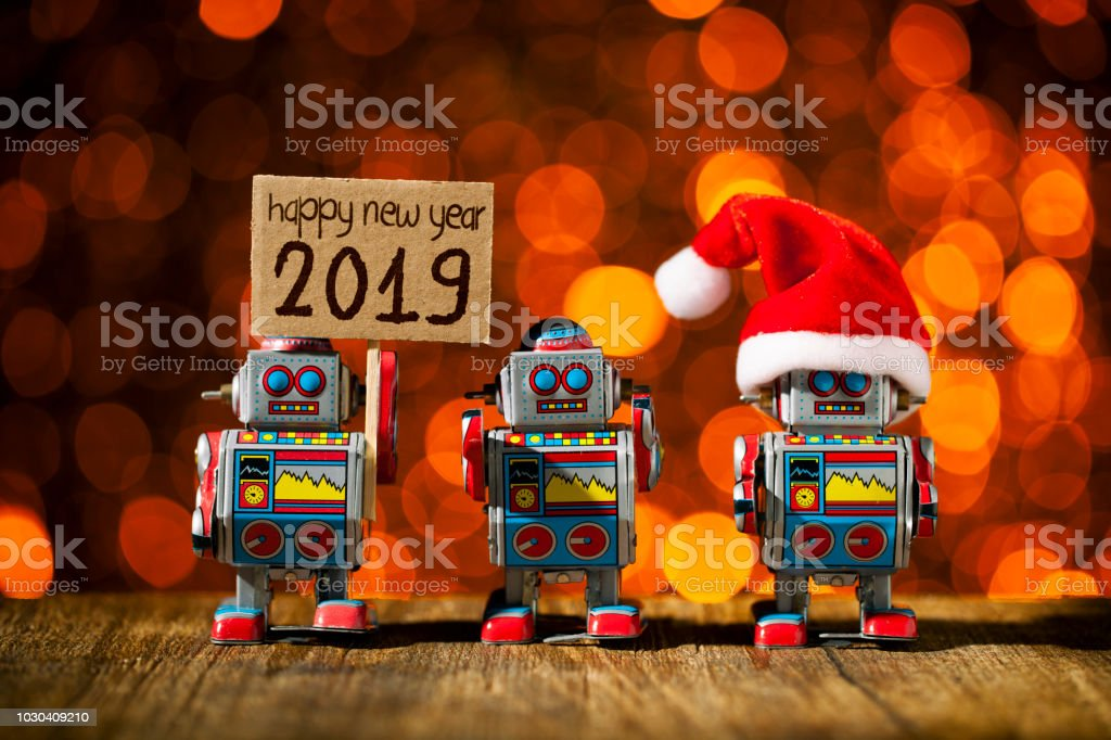 New year 2019. Three retro robots posing for Holidays - Christmas Santa Fun Humor royalty-free stock photo