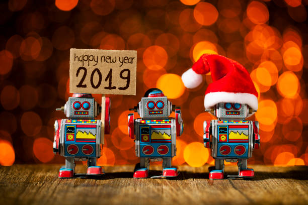 New year 2019. Three retro robots posing for Holidays - Christmas Santa Fun Humor stock photo