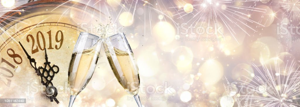 New Year 2019 - Toast With Champagne And Clock stock photo