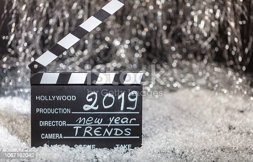 istock New year 2019 trends on movie clapper, abstract bokeh lights background 1067162042