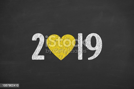 istock New Year 2019 with Heart Shape on Chalkboard Background 1057902410