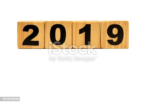 1054929988 istock photo New Year 2019 with wood block isolated on white background 942603648