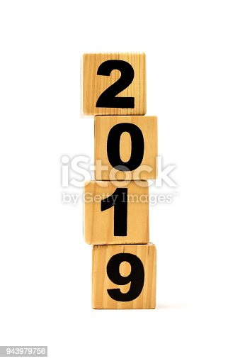 1054929988 istock photo New Year 2019 with wood block isolated on white background 943979756