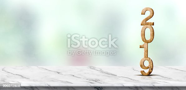 istock New year 2019 wood number (3d rendering) on white marble table at blur abstract green bokeh background,Mock up banner space for display or montage of product,holiday celebration greeting card. 996572928