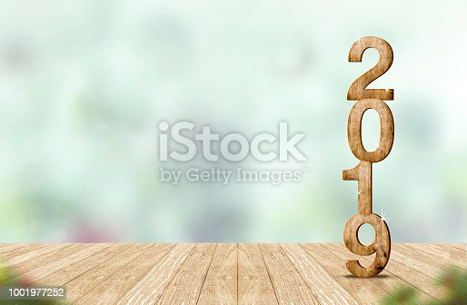 istock New year 2019 wood number (3d rendering) on wooden plank table at blur abstract green bokeh background,Mock up banner space for display or montage of product,holiday celebration greeting card. 1001977252