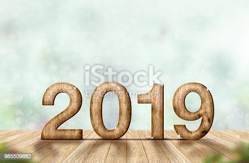istock New year 2019 wood number (3d rendering) on wooden plank table at blur abstract green bokeh background,Mock up banner space for display or montage of product,holiday celebration greeting card. 985509882