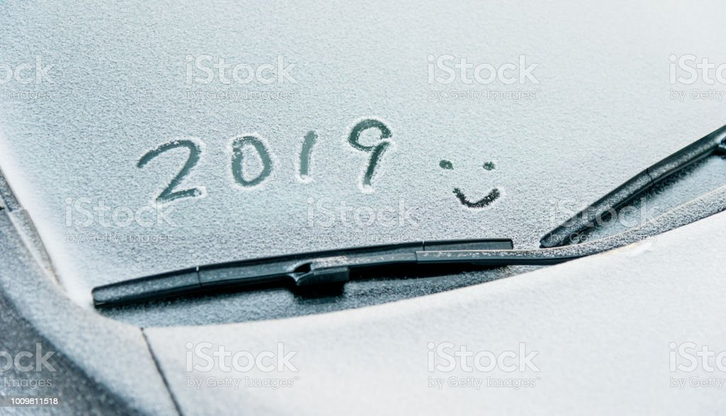 New year 2019 written on car windshield stock photo