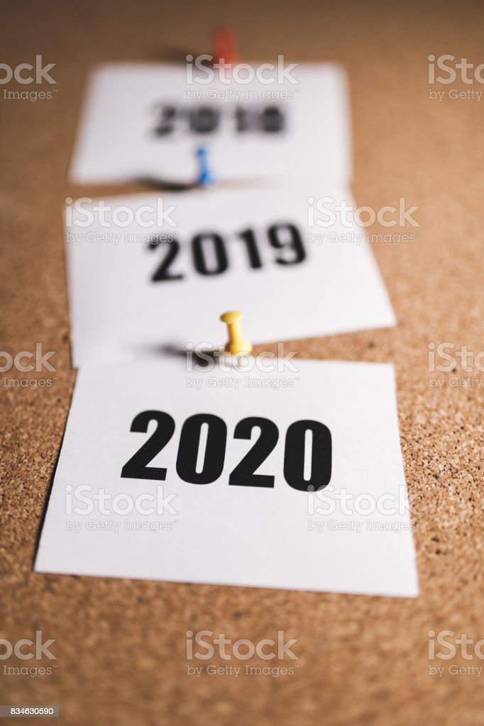 New year 2020 and future on bulletin board stock photo