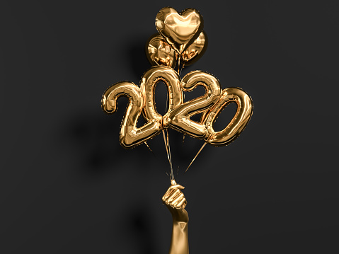 New year 2020 celebration. Gold foil balloons numeral 2019 holding hand on black wall background