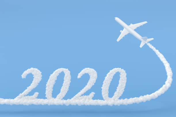 New Year 2020 drawing by airplane on blue background stock photo