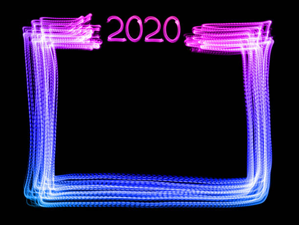 New year 2020 frame - LED light painting (multi colored) stock photo