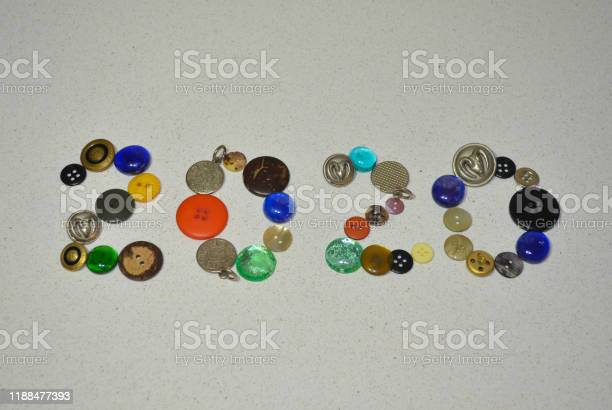 New year 2020 made with color buttons on white background. Creative concept for  the next year.