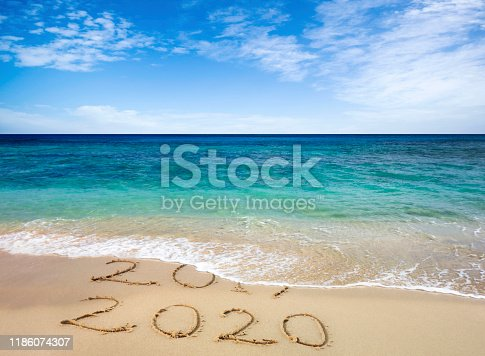 istock New year 2020 replacing 2019 on beach 1186074307