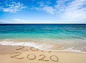 New year 2020 replacing 2019 on beach