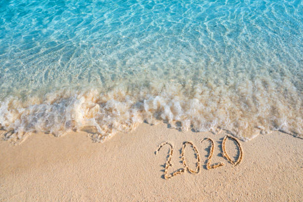 new year 2020 summer concept ,soft wave lapped the sandy beach background - new years day stock pictures, royalty-free photos & images