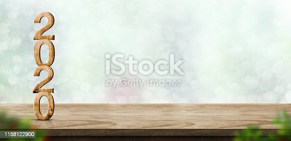 istock New year 2020 wood number (3d rendering) on wooden table at blur abstract green bokeh background,Mock up banner space for display or montage of product,holiday celebration greeting card. 1158122900