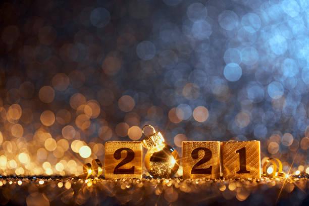 New Year 2021 Christmas Decoration - Gold Blue Party Celebration Wood Cube stock photo