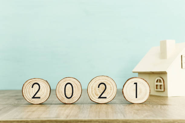 New year 2021 concept. business idea over wooden board stock photo