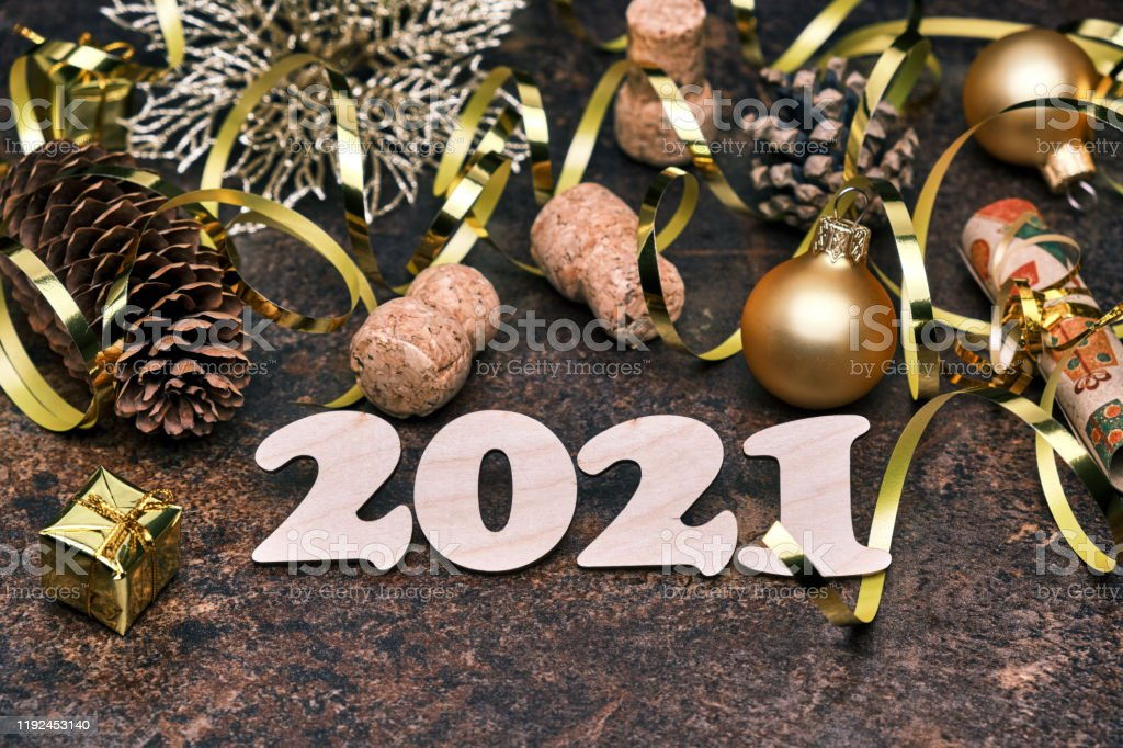 new year 2021 festive background with wooden numbers 2021 pine cones golden christmas ball gift box and christmas decorations stock photo download image now istock https www istockphoto com photo new year 2021 festive background with wooden numbers 2021 pine cones golden gm1192453140 338810911