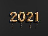 New year 2021 gold and black. Gold foil balloons numeral 2021 isolated on black background. 3D rendering