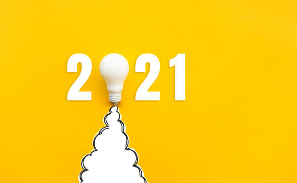 New year 2021 Ideas,inspiration concepts with rocket light bulb on yellow background stock photo