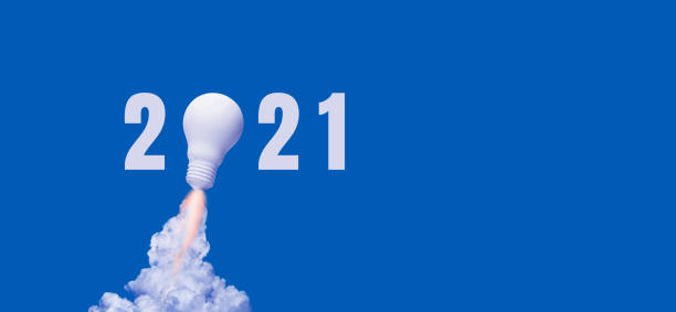 New year 2021 Ideas,inspiration concepts with rocket light bulb on blue background stock photo