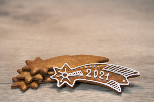 New Year 2021 on ornate gingerbread Bethlehem star for good luck laid on a wood background stock photo