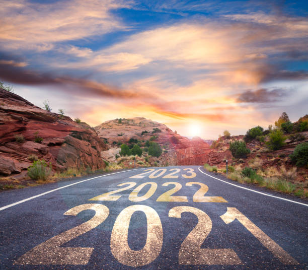 New Year 2021 road with sunrise and upcoming years ahead stock photo