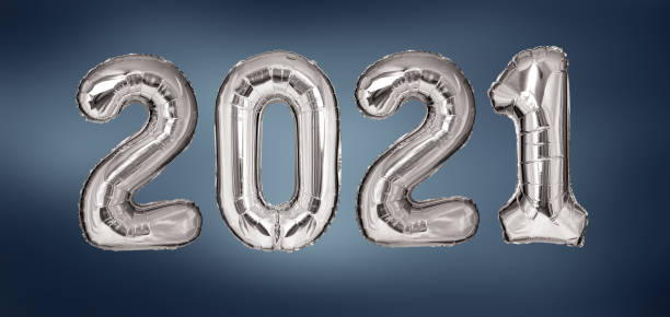 New Year 2021 silver balloons on blue background stock photo
