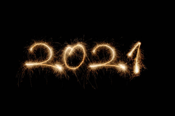 new year 2021 sparklers stock photo