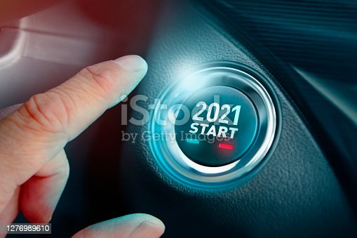 Hand pushing New Year 2021 start button