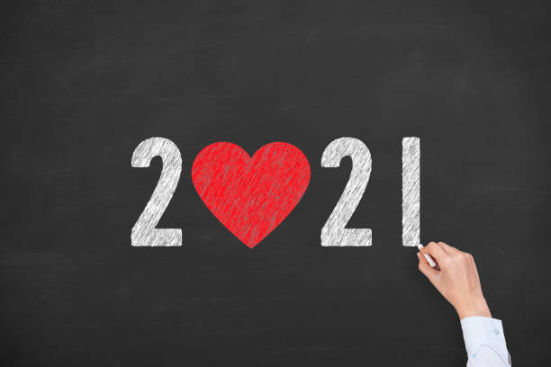 New Year 2021 with Heart Shape on Chalkboard Background stock photo